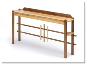 "Bruce's Hall/Entry table is made of birdseye maple and walnut. It measures 34"" H x 67"" L x 16"" W."