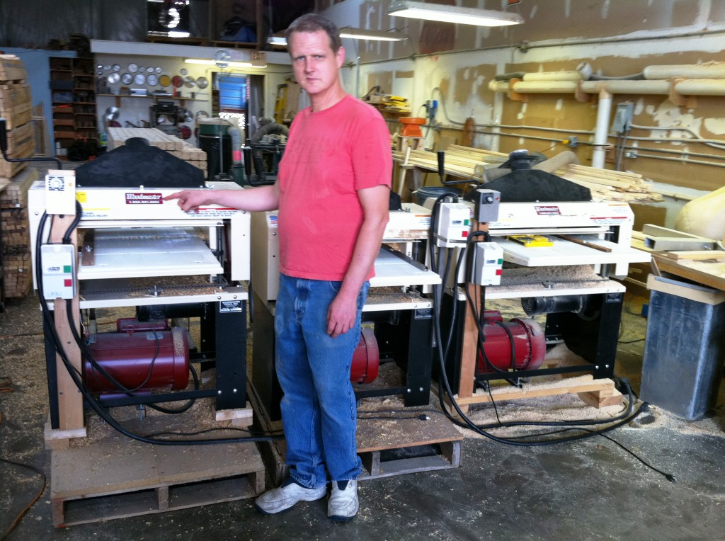 "Andy McQuatters with the three Woodmaster Molder/Planers in the shop he and his dad operate in Florida, ""Andy's Place."""