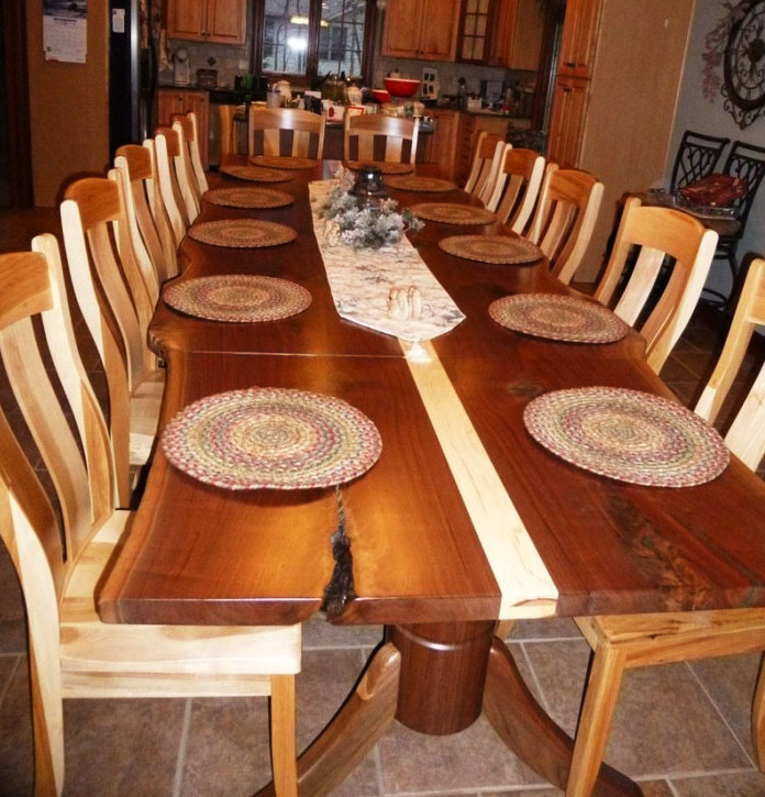 Jared sells his slabs to woodworkers who turn them into remarkable, unique furniture, mantles, and more. Woodworker, Chuck Davis used two book-matched walnut slabs to make this dining table accented with hickory inlay.