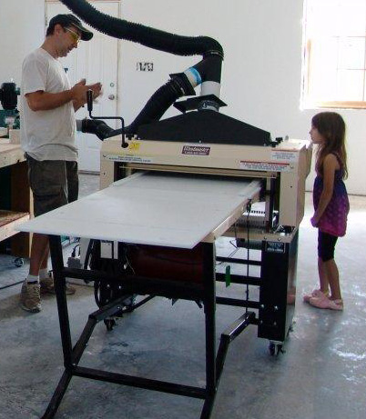 "Here's Mike and his Woodmaster with his #1 helper, his daughter Loren, 7. ""She wants me to make her a race car,"" he says."