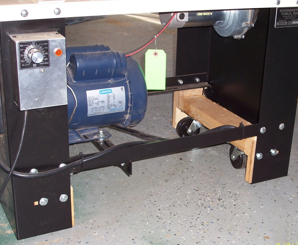 Johnny found a way to retrofit his Woodmaster to lower the working height several inches so he could work seated in his wheelchair. He's recessed the wheels inside the cabinet so the chassis rides just a half-inch off the floor.