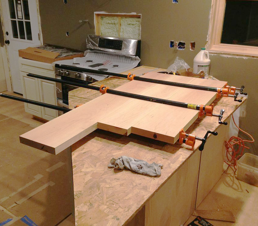 The Phoenix place is shaping up as Eli glues up wide cherry boards he cut and planed into his kitchen counters.