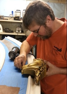 Kurt Zolman fits a carved applique to a section of curved molding he made with his Woodmaster Molder/Planer.