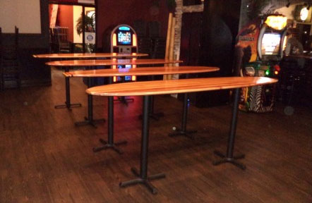 A southern California bar wouldn't complete without Dana's stand-up surfboard bar tables.