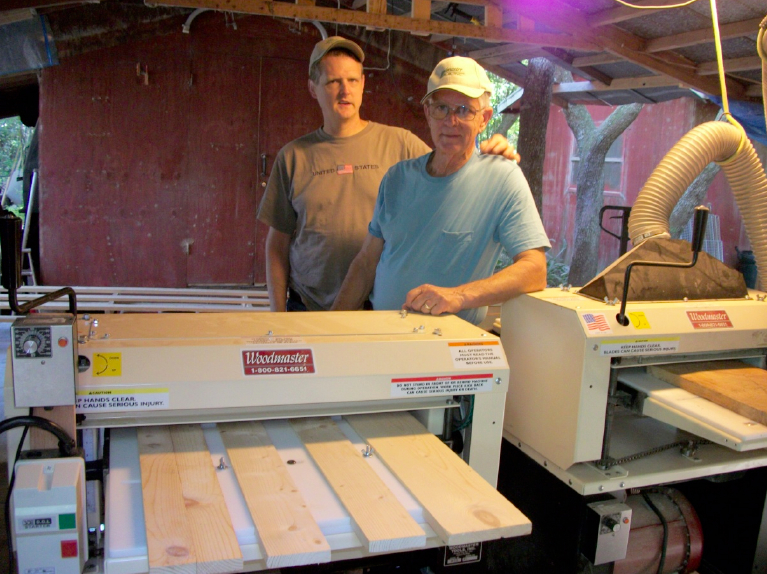 "Bill McQuatters, right, started a woodworking business with his son, for the benefit of his autistic son's long range future. Andy handles the work well and ""he works all day long,"" says Bill."
