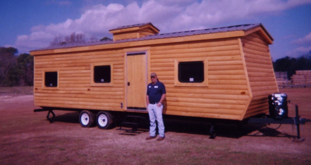 Here's something you don't see every day -- a genuine log cabin travel trailer. The Parmers renovated it with log cabin siding outside and custom paneling inside...all made with their Woodmaster Molder/Planer.