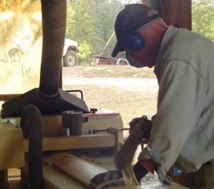 """Myrle and Bill, Steve's mom and dad, put in a good days work running log cabin siding on the Woodmaster. """"They like doing it,"""" says Steve."""