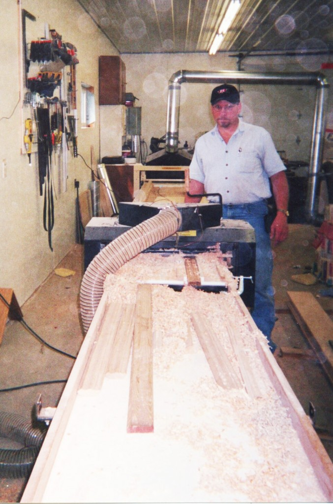 Here's Tim's molding production line. The hood's off the Woodmaster Molder/Planer as he makes some fine adjustments.
