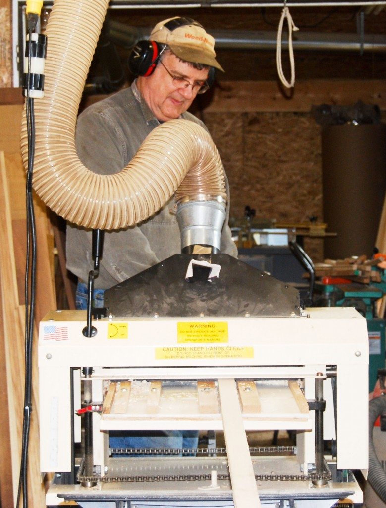 Tom Bardwell runs a strip of molding through his Woodmaster Model 718. What started as a hobby has turned into a successful molding business that employs and supports his family of five.