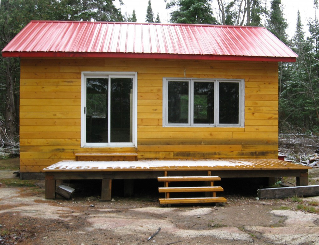 What kind of camp would YOU build in retirement? Hunting cam? Weekend getaway? Ferdinand planed his camp's siding from 2 x 8 material. When you have 100 acres of woods, you can build your camp any way you want to.