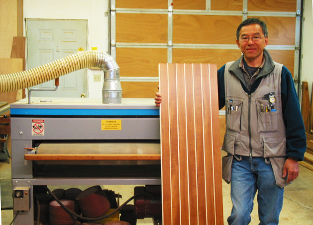 "Here's Glen Taniguchi with his Woodmaster Drum Sander and an example of some of the work he does as he's building and restoring high-end boats in his Washington state shop. ""I couldn't do the work I do without the Woodmaster,"" he says. ""It gives me an edge over my competition."""
