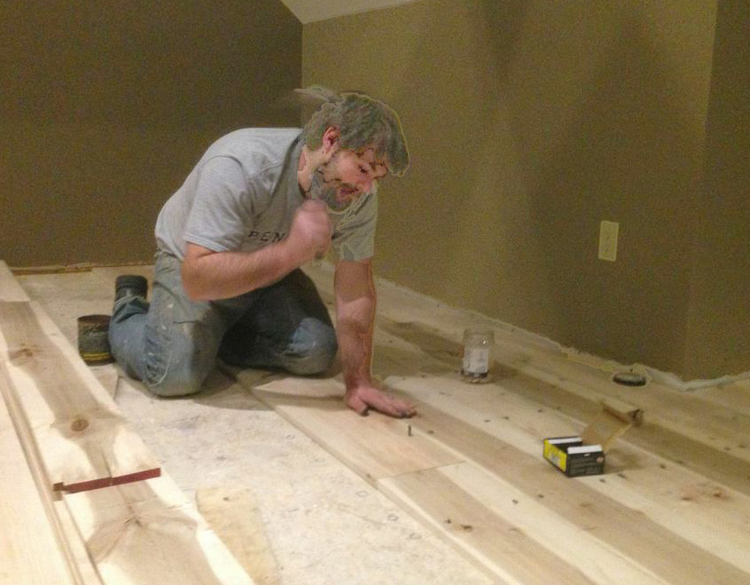 """Get ready for late nights and long weekends,"" says Eli. Here he's laying down hardwood flooring he made."