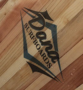 "Woodworkers talk about ""putting their mark"" on their work. Dana does exactly that. His remarkable wooden surfboards bear his logo -- Dana Surfboards."