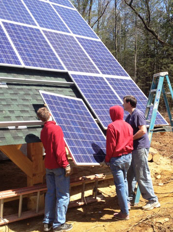 Solar panels help make the Esiason's new home self sufficient. They're totally off the grid.