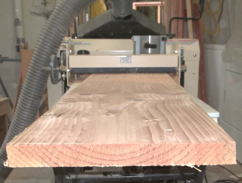 Wood emerges from the Woodmaster Molder/Planer...