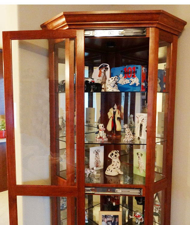 """Ed's finished curio cabinet houses his wife's collection of """"1,001 Dalmations"""" collectibles and memorabilia. Note the cabinet door SLIDES sideways to open. Nicely done, Ed!"""