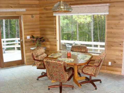 """Abe redid his dining room with log cabin siding he made on his Woodmaster. His wife calls the room, """"Abe Lincoln's log cabin."""" And, yes, Abe's middle name is Lincoln!"""