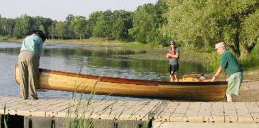 "Chuck and Dale take one of the canoes they made with their Woodmaster out on its first ""sea trial."" A proud moment!"