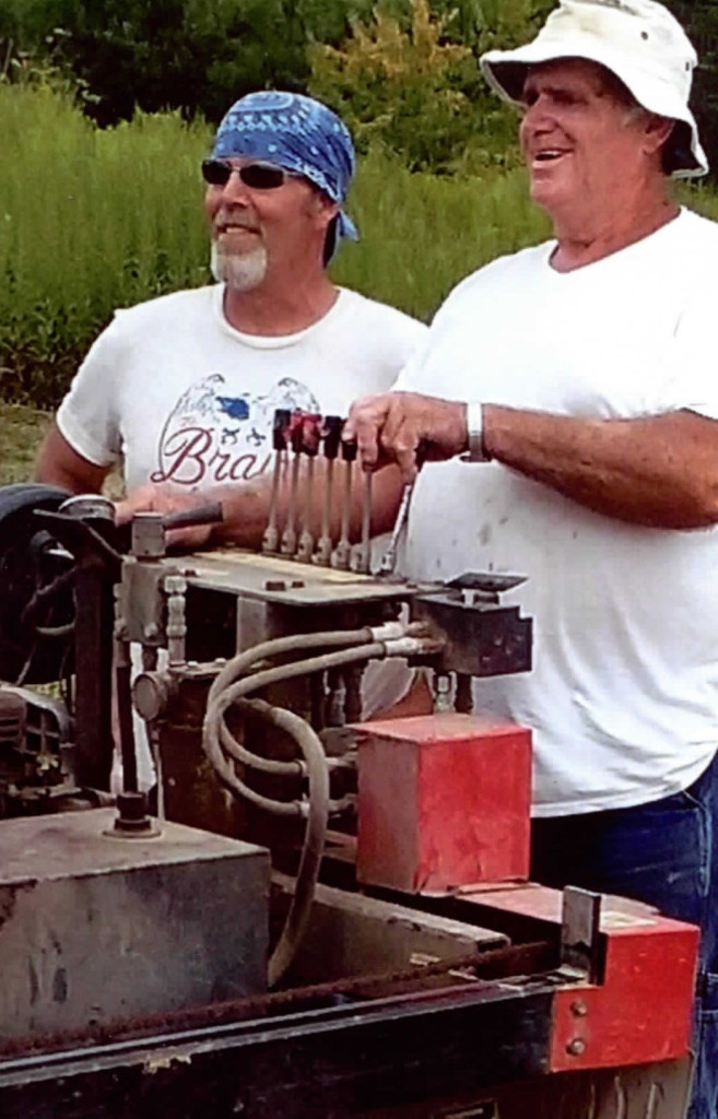 Larry (right) and his son-in-law saw out some boards on Larry's TimberKing sawmill. Next step: drying, then planing on his Woodmaster.