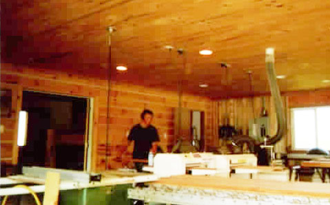 Here's a photo of the interior of Larry's shop. Note the walls and ceiling are wood paneling. Lots of room for Larry's many projects.
