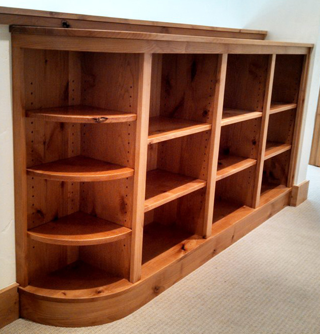 Here's some handsome shelving, especially with the curved shelves and corresponding curved base trim.