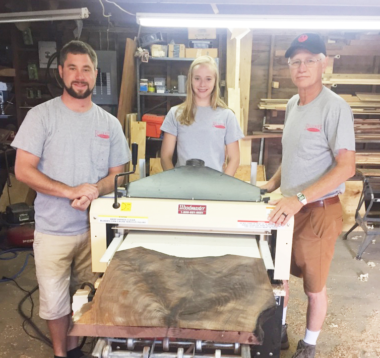 faMeet Peter's family work crew — Stephen, left, Ellie, Peter. And Peter's Woodmaster Molder/Planer! Two other sons took their turns on the Bellerive family crew and have gone on to careers of their own.