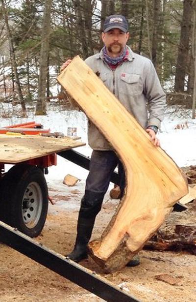 Next step, Josh saws them into L-shaped slabs.