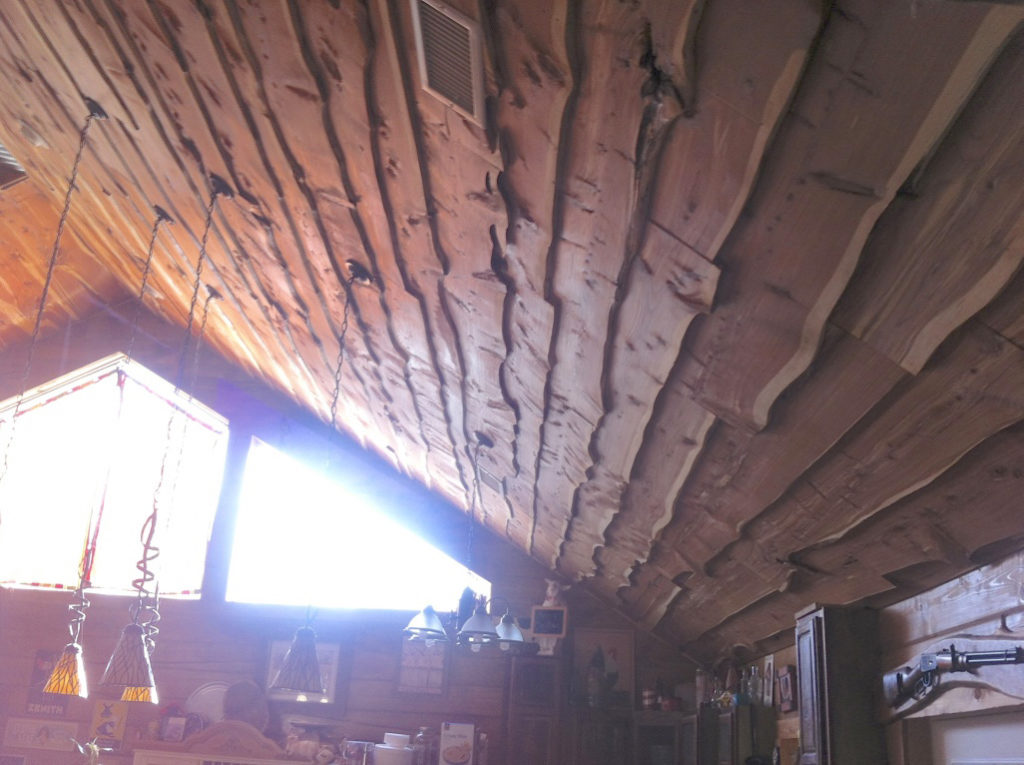 Take a look at the ceiling detail. Live edge boards, planed on the Woodmaster, make a distinctive and handsome rustic statement.