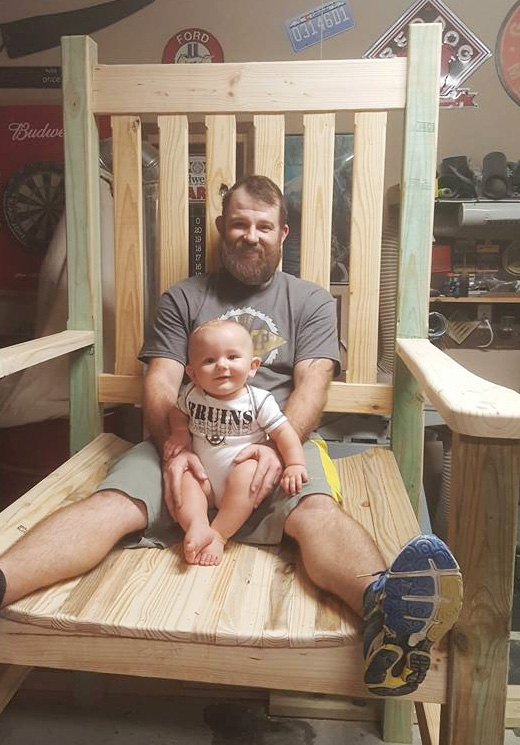 Jeff built a 7' tall chair for a local realtor. After assembly, and before painting it, he and his son, Lucas, shared a great photo opportunity.