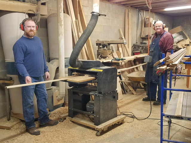 Dave's son (left) gives dad a hand running molding through Dave's 1980's era Woodmaster Molder/Planer