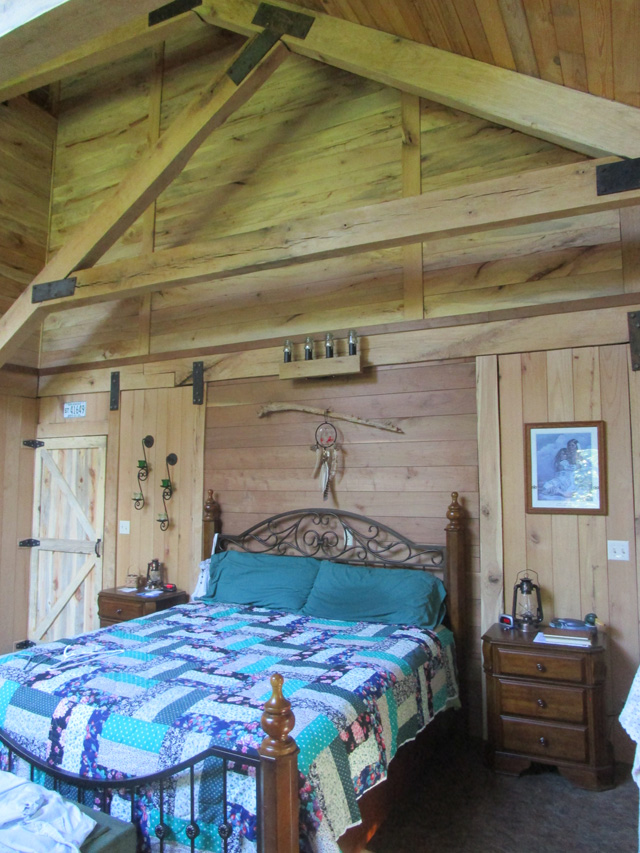 Tom's master bedroom made of walnut, oak, and pecan woods.