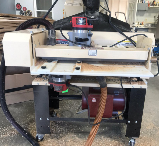 "Darrell chose the 25"" Woodmaster. Here, he has it set up with the 3-Side Molding attachment allowing him to shape 3 sides of his flooring in a single pass. The planer cuts the back relief and the 2 Milwaukee routers shape the tongue and groove sides. 3 sides, 1 pass."