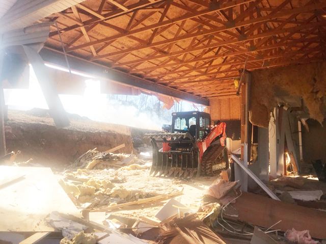 Darrell Bice doesn't fool around. He started his home remodeling job with a skid-steer. He demolished much of the building, leaving the truss roof structure intact. Then built his new home beneath it!